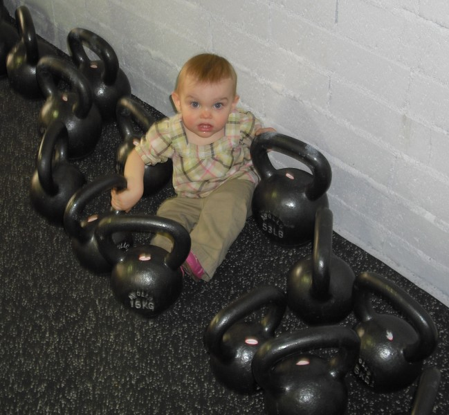 A sack of flour amidst the kettlebells - the Freischlag clan starts 'em young.