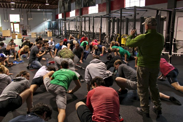 Kelly Starrett leads group at Invictus Training Camp