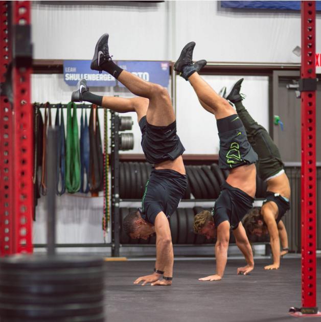 Invictus Athletes Jeff Evans, Rasmus Andersen and Lauren Fisher from CrossFit Invictus in San Diego