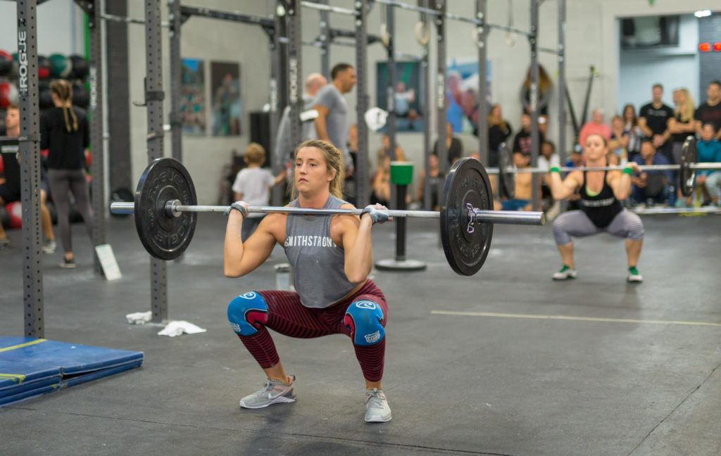 Thrusters performed during a CrossFit workout by Invictus Athlete, Brittany Weiss
