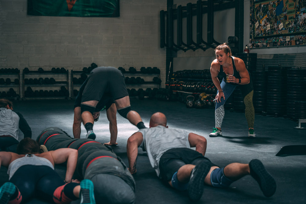 group burpee challenge during a CrossFit workout